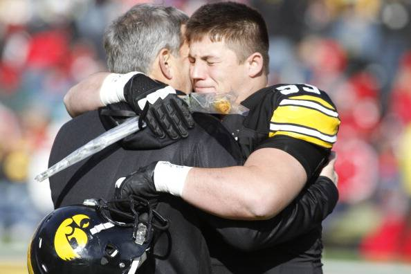 12 steps to authentic fathering: Nebraska v Iowa - father hugs son